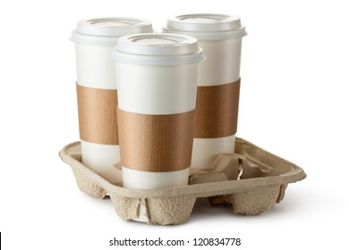 Three take-out coffee in holder. Isolated on a white.