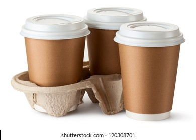 Three take-out coffee. Two cups in holder. Isolated on a white.