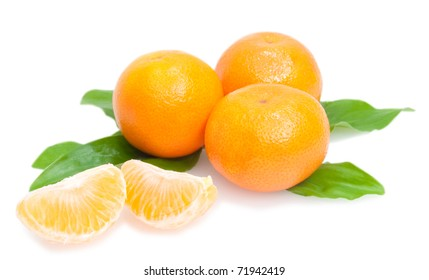 three tangerines and segments with green leaves isolated on white background