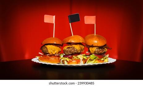 Three tasty mini burgers at the nice club restaurant