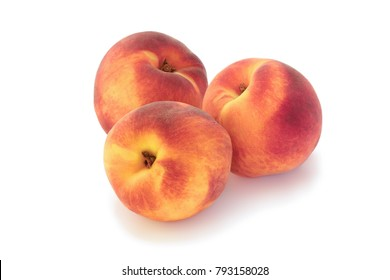 Three tasty peaches isolated on white background