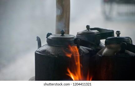 Three tea kettles around a tea shop unique photo