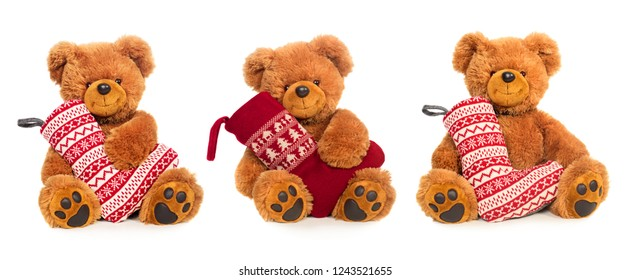 Three Teddy bears with Christmas stocking isolated on white background