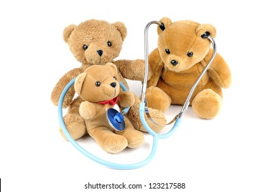 Three teddy bears and a stethoscope