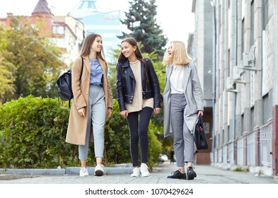 three teen girls in a street. stylish young women girlfriends