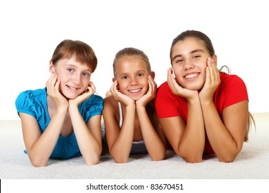 Three teenage girls together in studio against white background