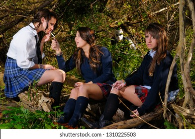 Three teenage private school girls hiding in a forest to smoke cigarettes with man in hockey mask
