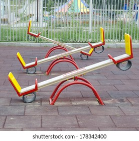 Three teeter totters. Shot on a playground