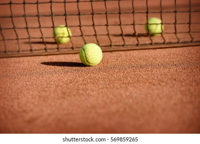 Three tennis balls on tennis court