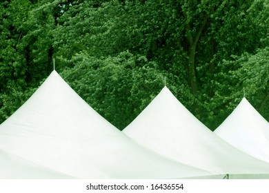 three tent roofs at an event