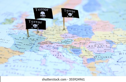 Three Terror warning flags over France, Belgium and Germany on a map of Europe - illustration image. Selective focus. One flag is out of focus. Side view