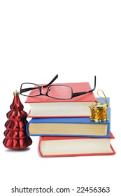 three thick book with glasses and new year toys