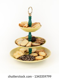 Three Tier  Mid-Century Modern Serving Dish with Yellow Glazed Plates  and Green Bakelite Stem with Brass Ring Handle for Desserts or Appetizers with Tea Time Cookies.