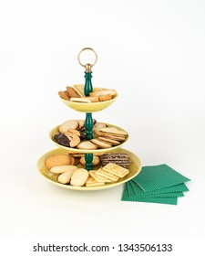 Three Tier  Mid-Century Modern Serving Dish with Yellow Glazed Plates  and Green Bakelite Stem with Brass Ring Handle for Desserts or Appetizers with Tea Time Cookies and Napkins.