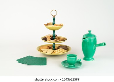 Three Tier  Mid-Century Modern Serving Dish with Yellow Glazed Plates  and Green Bakelite Stem with Brass Ring Handle for Desserts or Appetizers with Coffee Carafe and Demitas Cup and Cookies