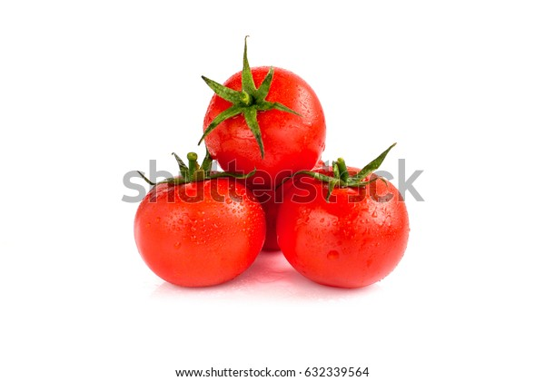 Three tomatoes isolated on white