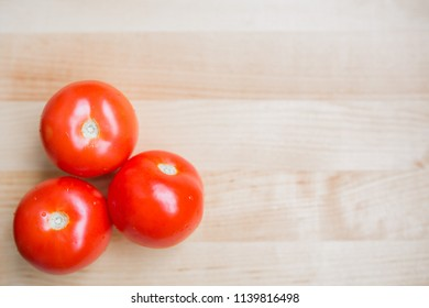three tomatoes on the table