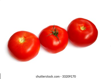 Three tomatoes in a row, on the white background
