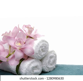Three towels with orchid flower on blue background