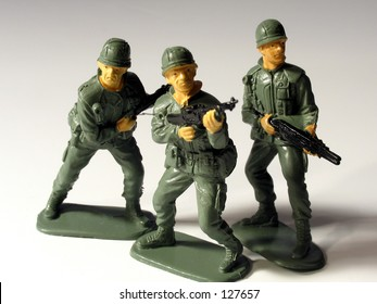 Three toy soldiers on white background