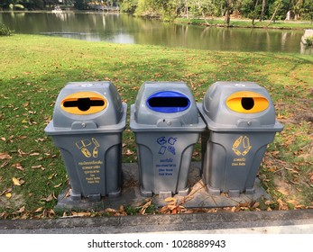 Three trash bin with different garbage symbols and different garbage bin. To tell the type of garbage to separate.