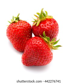 Three trawberries with leaves, isolated on a white background.