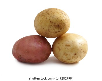 three tubers red white potatoes isolated on white background close-up