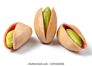 Three turkish red pistachios (Antep Fistigi) peeled green nuts visible under shell, isolated on white background.