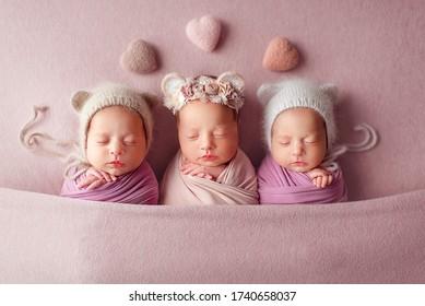 three twin sisters are sleeping sweetly