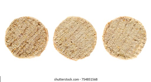 Three uncooked meat cutlets isolated on white background. Top view