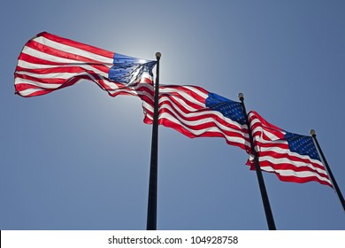 Three United States of America Flags Blowing in the Wind.