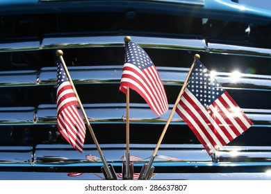 Three United States (US) flags on vehicle front