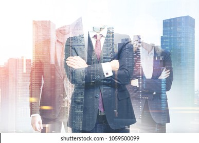 Three unrecognizable confident company leaders standing against a modern cityscape background. Leadership concept. Toned image double exposure