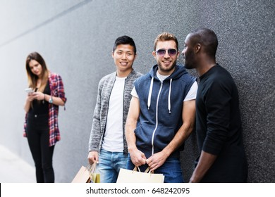 Three urban guys shopping and laughing-multiple ethnicity