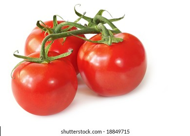 Three vine-ripened beefsteak tomatoes, isolated on white with natural shadow.