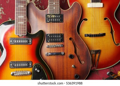 Three vintage electric guitars.