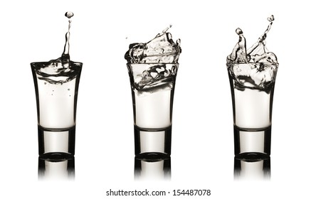Three vodka glasses with splashes, clipping path is included
