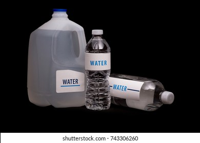 Three water containers on isolated black background