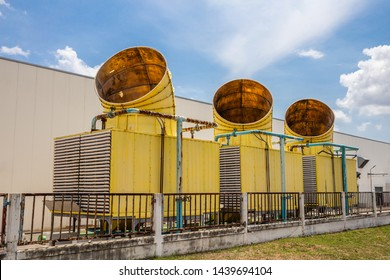 Three of water cooling tower of air conditioner system outside factory. Old and rusty