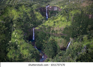 Three Waterfalls in jungle of Kauai from above.
