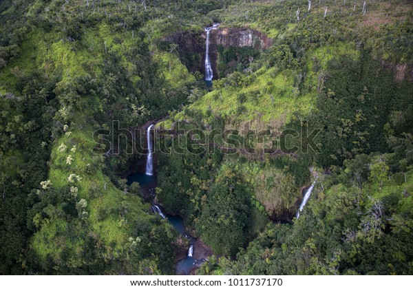 Three Waterfalls in jungle of Kauai from above.