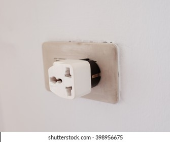three ways plug  adapter connected on wall ready for using