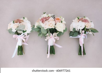 Three wedding bouquets of bride and her bridesmaids