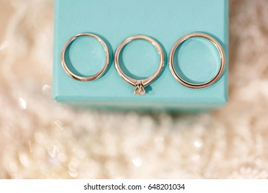 Three wedding rings. Engagement ring, bridal ring and groom ring on the box.