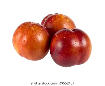 Three wet peaches isolated over white background