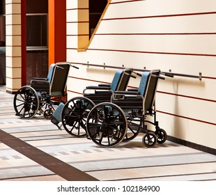 Three wheelchairs in the hospital.