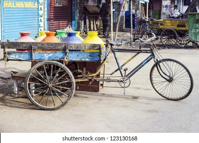 three wheeler bike at the market with drinking water and juices