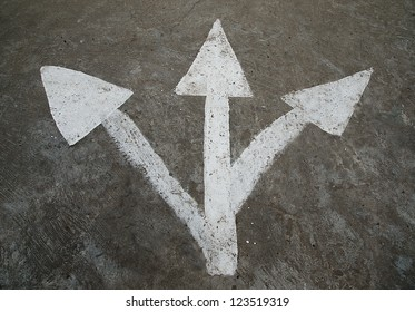 Three white arrow on the road