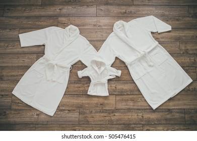 Three white Bathrobe