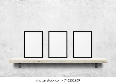 Three white blank photo frames mockup on shelf over white concrete wall background